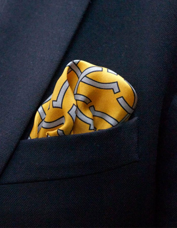 Silver interlinked rings Yellow silk pocket square – The Kholeno